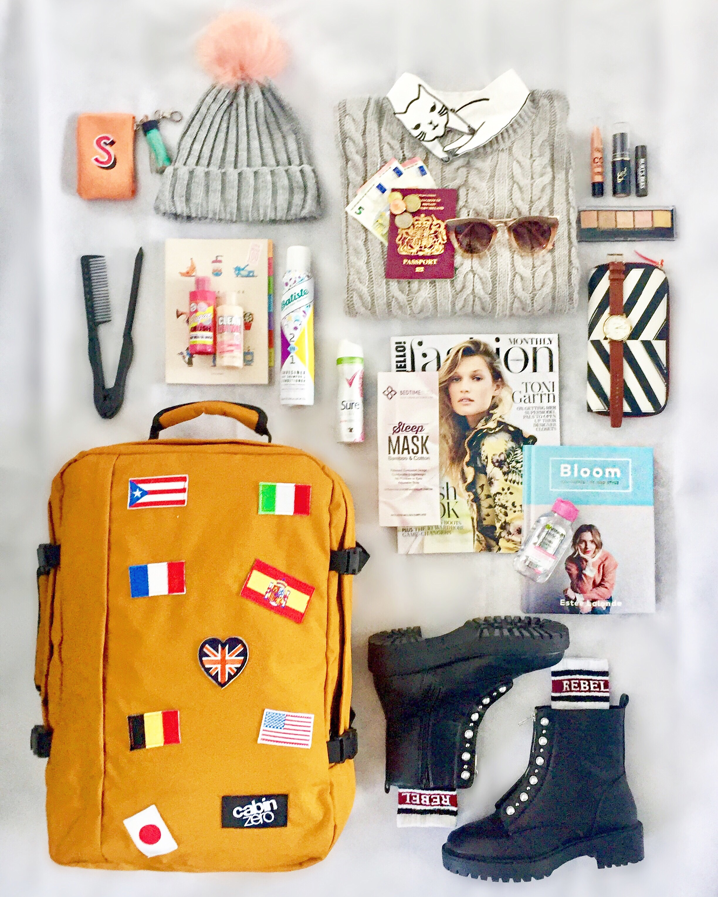 Cabin Zero flags bag luggage packing flatlay via Always a Blue Sky Girl style travel fashion lifestyle blog
